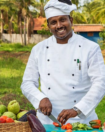 Picture of the Dune hotel chef preparing organic food from domestic farm