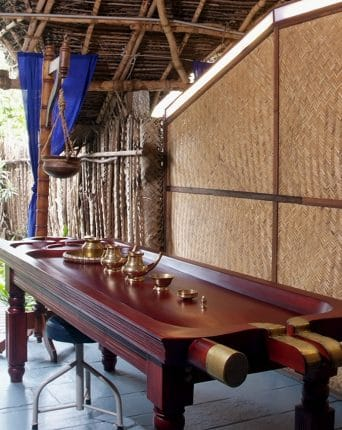 Massage table specialized for massage using hot oil. Service of the Deepak Chopra Ayurvedic Medicine Center located within the Dune Eco Village and Spa Hotel