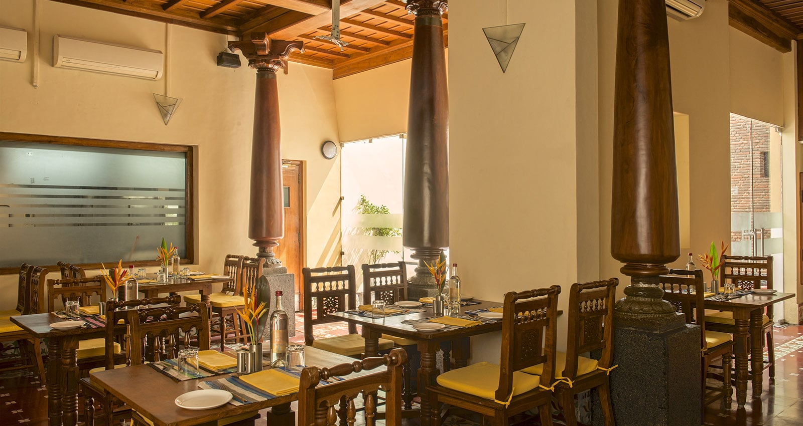 "Inside view of Restaurant ""La Méditerranée"" at Dune Mansion Calvé Hotel in Puducherry India"