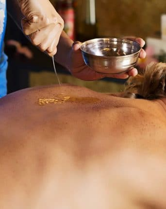 Image of Ayurvedic massage with oil treatment